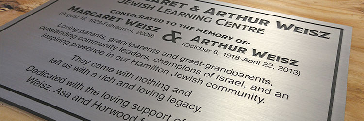 Brushed aluminum metal plaque with black text engraved